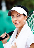 Professional female tennis player with towel on her shoulders — Stock Photo