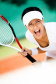 Sportswoman in sportswear playing tennis — Stock Photo