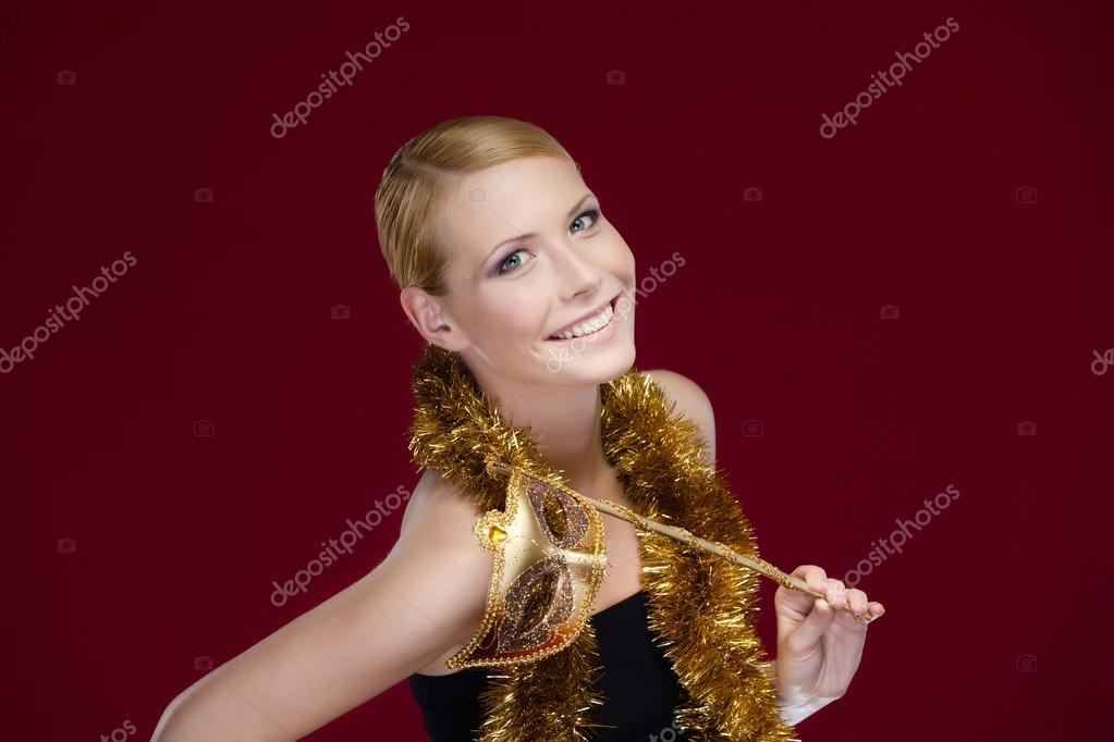 Attractive woman with masquerade mask and tinsel, isolated on purple — Stock Photo #14338201