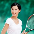 Stock Photo: Portrait of professional female tennis player