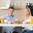 Married couple has a snack in the kitchen — Stock Photo