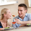 Man feeds his girlfriend - Stock Photo