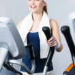 Athlete woman training on gym equipment in gym — Stock Photo