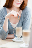 Lady is stirring the milk shake — Stock Photo