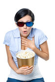 Girl in 3D glasses watching cinema with bowl of popcorn — Stock Photo