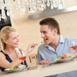Husband and wife have romantic dinner - Stock Photo