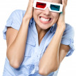 Putting hands on the head girl watching 3D cinema - Stock Photo