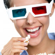 Headshot of the girl in 3D glasses eating popcorn — Photo