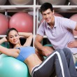Stock Photo: Woman exercises in fitness gym