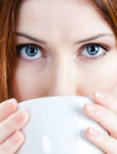 Young woman with cup of tea — Stock Photo