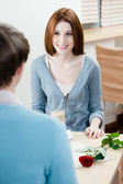 Man and girl are at the table — Stock Photo