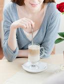 Woman is stirring the shake — Stock Photo