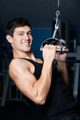 Athletic man works out on fitness gym training — Stock Photo