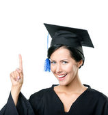 Smiley graduating student making the attention gesture — Stock Photo