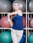 Sportive woman stretching herself — Fotografia Stock