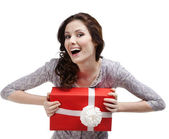 Laughing young woman hands a gift — Stock Photo