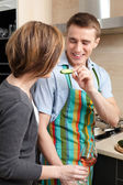 Man feeds his wife with vegetables — Stock Photo