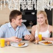 Husband and wife have breakfast in the kitchen — Stock Photo