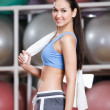 Sportive pretty woman in fitness gym — Stock Photo