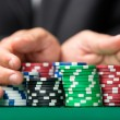 "Gambler going ""all in"" pushing his chips forward — Stock Photo #18975855"