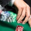 Gambler stakes the pile of poker chips — Stock Photo