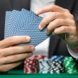 Stock Photo: Gambler playing poker cards with poker chips on the table