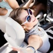 Girl in the car with her hands up — Stock Photo #18976243