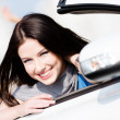 Close up view of woman in the white car — Stock Photo