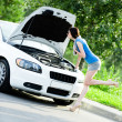 Woman repairing the broken white car — Stock Photo