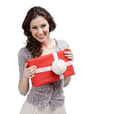 Young woman hands a present with white bow — Stock Photo