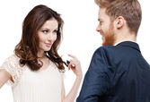 Pretty woman looks slily at her boyfriend — Stock Photo