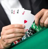 Gambler shows cards 4 aces — Stock Photo