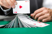 Gambler playing with poker cards — Stock Photo