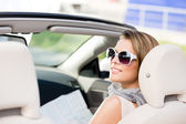 Girl with the road map in the car — Stock Photo