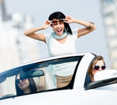 Lovely teenager stands in the car — Stock Photo