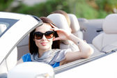 Portrait of dreamy woman in the white car — Стоковое фото