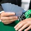 Stock Photo: Gambler playing cards with chips on the table