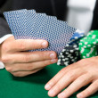 Gambler playing cards with chips on the table — Stock Photo