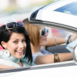Female friends in the white car — Stock fotografie