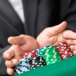 Poker player going all in pushing his chips forward. Challenge to the casino — Stock Photo #19386255