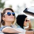 Close up of girls in sunglasses in the white car — Stock Photo