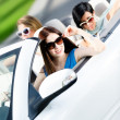 Group of happy teenagers in the car — Stock Photo