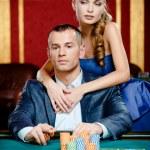 Girl embracing gambler at the casino table — Stock Photo #19387645