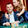 Stock Photo: Girl advises gambler safe bet