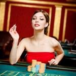 Girl gambles at the gambling house — Stock Photo #19387829