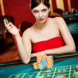 Girl plays at the casino club — Stock Photo #19387961