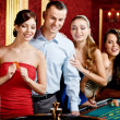 Stock Photo: Group of playing roulette