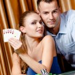 Couple playing poker — Stock Photo #19389215