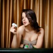 Female gambler at the casino table with chips — Stock Photo