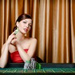 Female gambler sitting at the roulette table — Stock Photo